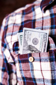 Hundred american dollars in the pocket of shirt — Stock Photo