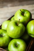 Fruit. apples in a basket on wooden table — Stockfoto