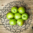 Fruit. apples in a bowl on wooden background — Stock Photo #75911995