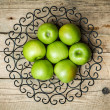 Fruit. apples in a bowl on wooden background — Stock Photo #75913079
