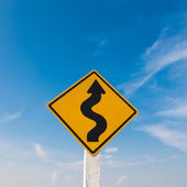 Winding road sign with a blue sky.  — Stock Photo