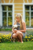 Girl and a small dog — Stock Photo