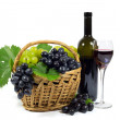 Fresh Red and White Grapes with Green Leaves in Wicker Basket, Wine Glass Cup and Wine Bottle Filled with Red Wine Isolated on White — Stock Photo #56648167