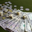 White Dices, Coins and American Dollar Bills on Green Table — Stock Photo #59021289