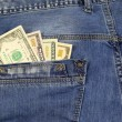 Jeans Pocket Full of American Dollar Bills — Stock Photo #59792683