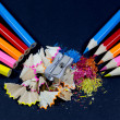 Sharpened Colorful Pencils Against Blunt Pencils with Metallic Pencil Sharpener and Colorful Pencil Shavings on Black — Stock Photo #60641693