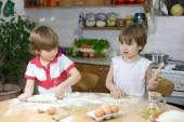Two Little Boys Playing with Dough at the Kitchen Table at Home — Stock Photo