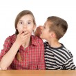 Boy Whispering Something to His Astonished Sister With Eyes Wide Opened Isolated — Stock Photo #73610543