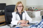 Doctor With Stethoscope Looking at Camera in Consulting Room — Stock Photo