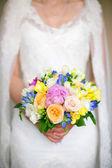 Bride holding a wedding bouquet. Wedding flowers closeup — Stock Photo