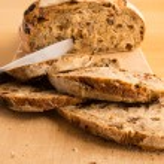 Knife in a Handmade Bread — Stock Photo #57596757