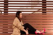 Sitting asian Girl waiting — Stock Photo