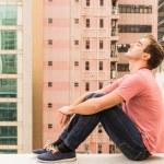 Man sitting on a Corbel — Stock Photo #64455517
