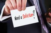 Need a Solicitor written on card — Stock Photo
