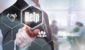 Businessman pressing Help button — Stock Photo