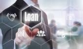 Businessman pressing Loan button — Stock Photo