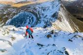 A hiker descending Helvellyn towards Striding Edge — Stock Photo