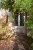 Door leading to secret garden — Stock Photo