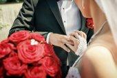 Bride put on wedding ring on groom's hand on wedding ceremony — Stock Photo