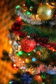 Christmas ball on Christmas tree with light garland. — Stock Photo