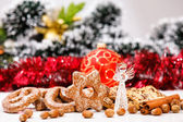 Cookies and decorative glass angel on de-focused christmas theme — Foto Stock