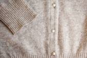 Angora wool cardigan with pearl button. — Стоковое фото
