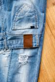 Pocket and label of ripped jeans — Стоковое фото