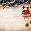 Plush christmas reindeer on wooden background — Stock Photo #58246295