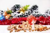 Cookies, glass angel, nuts, cinnamon sticks — Stock Photo