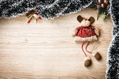 Plush christmas reindeer on wooden background — Stock Photo