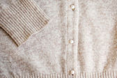 Angora wool cardigan with pearl button. — Stock Photo