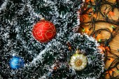 Christmas balls and light garland on wooden background. — Stock Photo