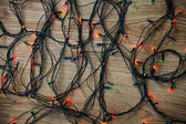 Light garland on wooden background. — Stock Photo