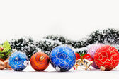 Christmas balls. Garland and Christmas bell in background. — Stock Photo