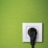 Black cable plugged in a white electric outlet — Zdjęcie stockowe