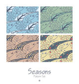 Set of seamless patterns with four seasons — Stockvektor