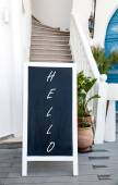 Blackboard advertising hello — Stock Photo
