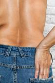 Woman with jeans topless — Stock Photo