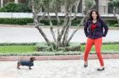 Women walking around town with dachshund dog — Stock Photo