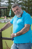 Attractive bearded man on a golf course — Stock Photo