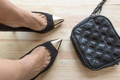 Woman legs putting on shoes — Stock Photo