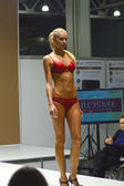 5th International Exhibition of underwear, beachwear, home wear and hosiery Lingrie Expo Moscow Aututumn September Young blonde woman in red underwear — Stock Photo