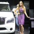 Постер, плакат: Moscow International Automobile Salon Young Brunette Women from Infiniti Team in violent dress near car