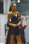 Moscow Traffic 5th International Exhibition of underwear, beachwear, home wear and hosiery Lingrie Expo Young beautiful brunette woman in in a black robe and black lingerie — Stock Photo