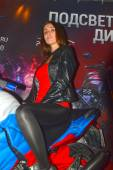 Moto Park 2015 Brown-eyed brunette model on a motorcycle — Stock Photo