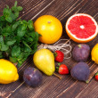 Grapefruits, pears, lemons, figs, strawberry, pomelo and mint on wooden background. Still life with fruits — Stock Photo #57283933