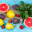 Grapefruits, pears, lemons, figs, strawberry, pomelo and mint on wooden background. Still life with fruits — Stock Photo #57283941