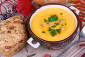 Fresh cooked pumpkin soup with smoked chicken breast — Stock Photo