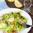 Fresh salad with mushrooms, squid and quail eggs — Stock Photo #59881255