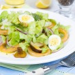 Fresh salad with mushrooms, squid and quail eggs — Stock Photo #59881287